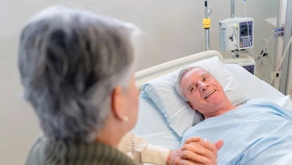 This image has an empty alt attribute; its file name is Couple-in-Hospital.jpg